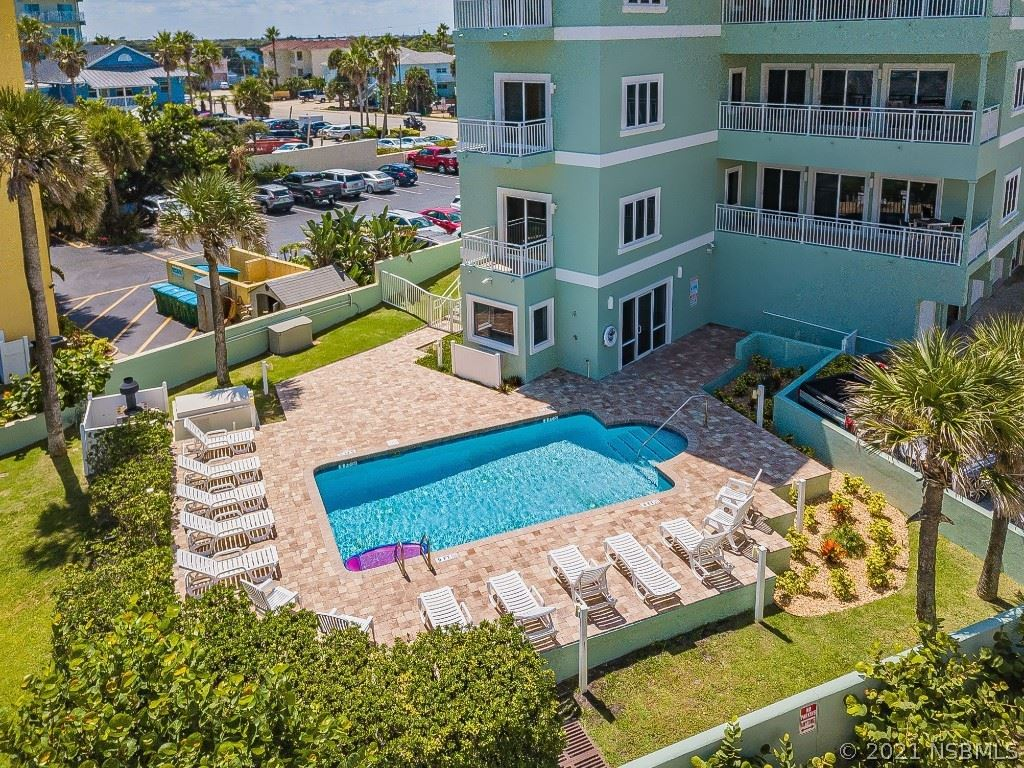 Photo of 423 S Atlantic Avenue #102, New Smyrna Beach, FL 32169 (MLS # 1066180)
