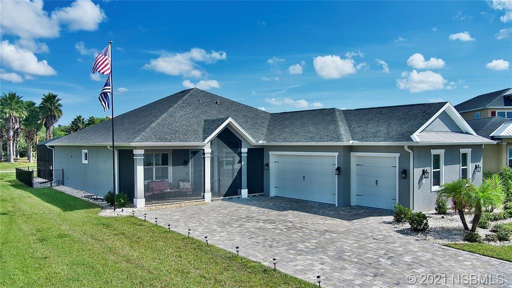Photo of 2948 Bella Flore Terrace, New Smyrna Beach, FL 32168 (MLS # 1066289)