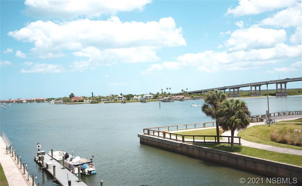 Photo of 101 N Riverside Drive #310, New Smyrna Beach, FL 32168 (MLS # 1063417)