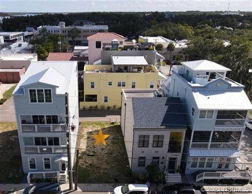 Photo of 142 Julia Street, New Smyrna Beach, FL 32168 (MLS # 1066484)