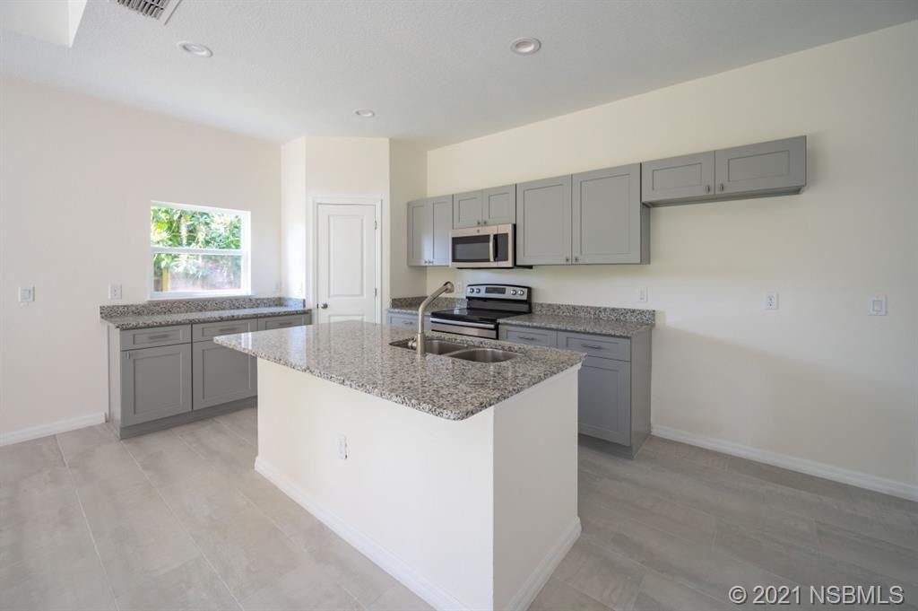 Photo of 327 Palm Street, New Smyrna Beach, FL 32168 (MLS # 1064521)