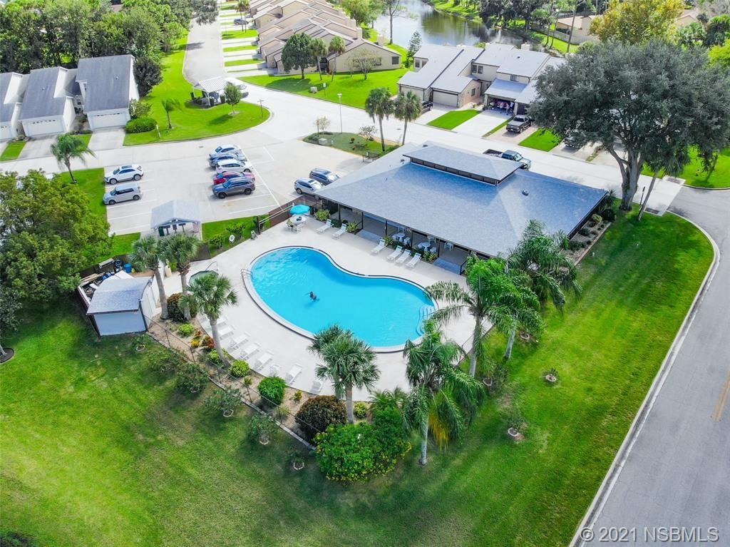 Photo of 2215 Candlewood Lane E, New Smyrna Beach, FL 32168 (MLS # 1066522)