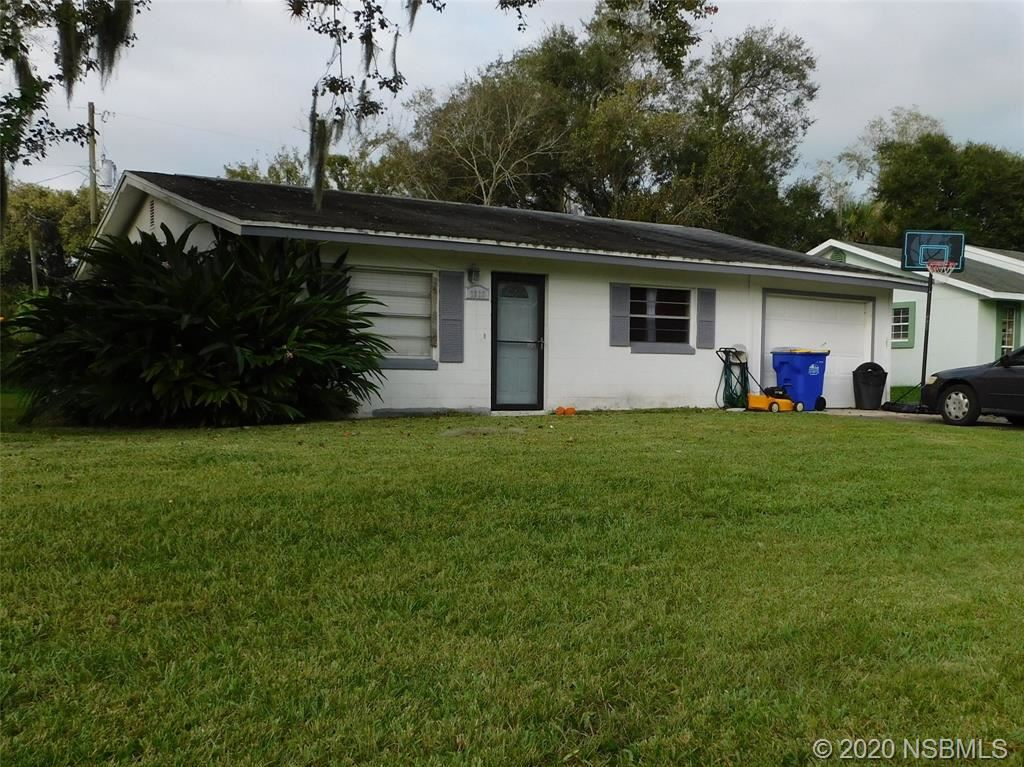 Photo of 2826 Travelers Palm Drive, Edgewater, FL 32141 (MLS # 1061543)