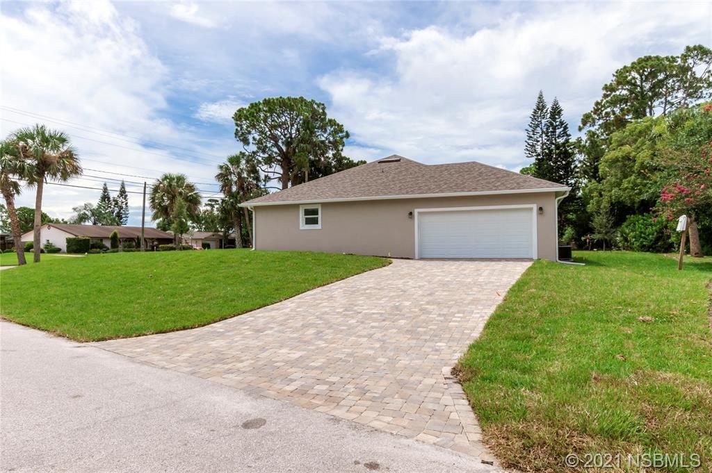 Photo of 830 Fairway Drive, New Smyrna Beach, FL 32168 (MLS # 1064554)