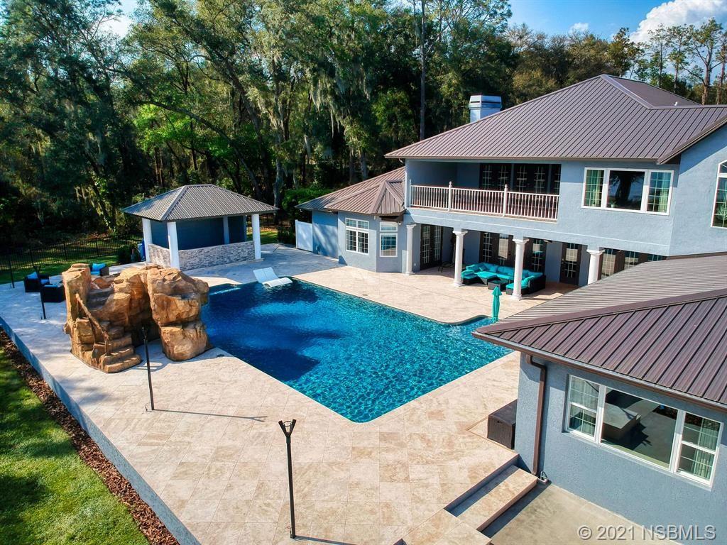 Photo of 38420 TIMBERLANE Drive, Umatilla, FL 32784 (MLS # 1062617)