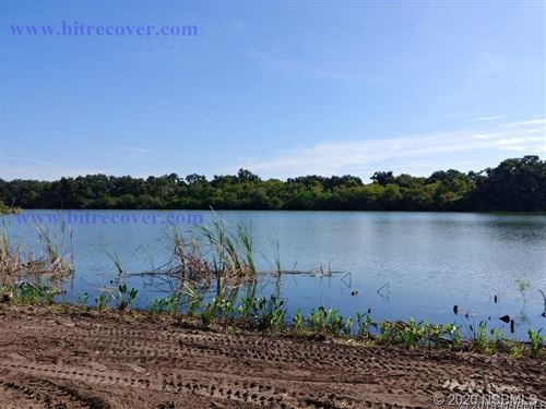 Photo of 1015 Stacy Lane, New Smyrna Beach, FL 32168 (MLS # 1060643)