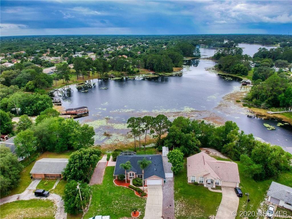 Photo of 1861 S Merrick Drive, Deltona, FL 32725 (MLS # 1058780)
