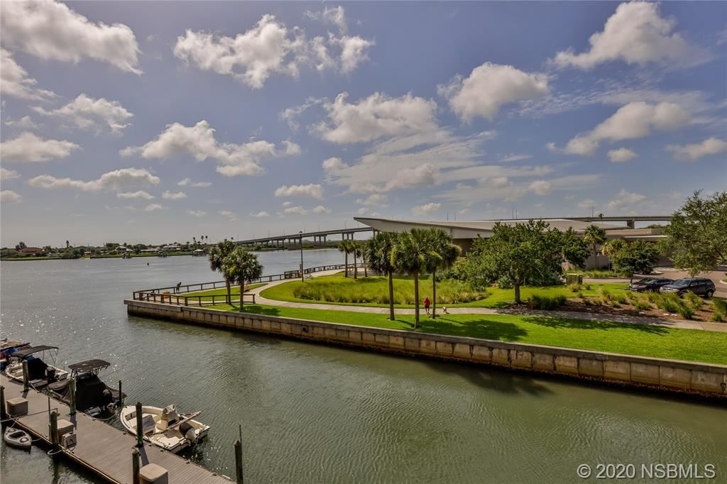 Photo of 101 N Riverside Drive #311, New Smyrna Beach, FL 32168 (MLS # 1058801)
