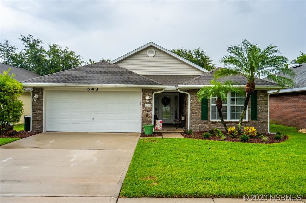 Photo of 643 Coral Trace Boulevard, Edgewater, FL 32132 (MLS # 1059823)