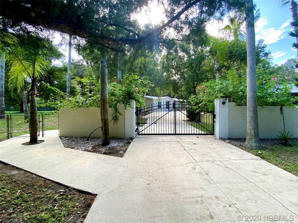 Photo of 926 Old Mission Road, New Smyrna Beach, FL 32168 (MLS # 1060825)