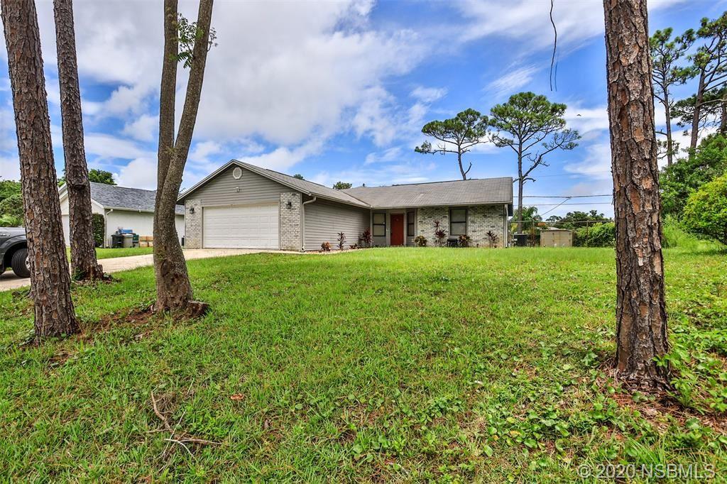 Photo of 2621 Travelers Palm Drive, Edgewater, FL 32141 (MLS # 1059836)