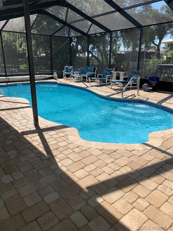 Photo of 166 Indian Creek Road, Oak Hill, FL 32759 (MLS # 1059875)