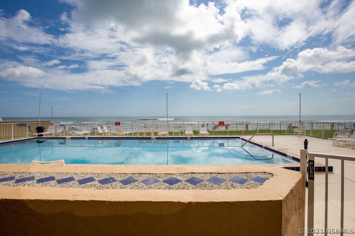 Photo of 421 S Atlantic Avenue #105, New Smyrna Beach, FL 32169 (MLS # 1065934)