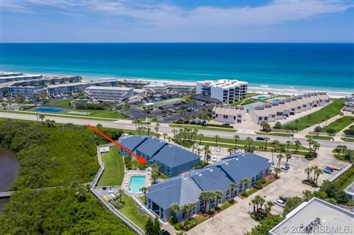 Photo of 4860 S Atlantic Avenue #105, New Smyrna Beach, FL 32169 (MLS # 1059939)