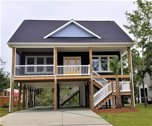 Photo of 319 NE 60th Street, Oak Island, NC 28465 (MLS # 100187020)