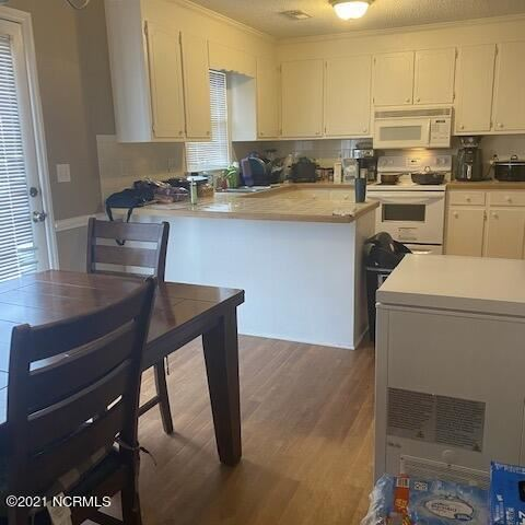 Photo of 3818 Sterling Pointe Drive #J3, Winterville, NC 28590 (MLS # 100291022)