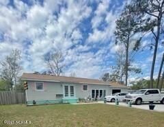 Photo of 209 NE 78th Street, Oak Island, NC 28465 (MLS # 100267029)