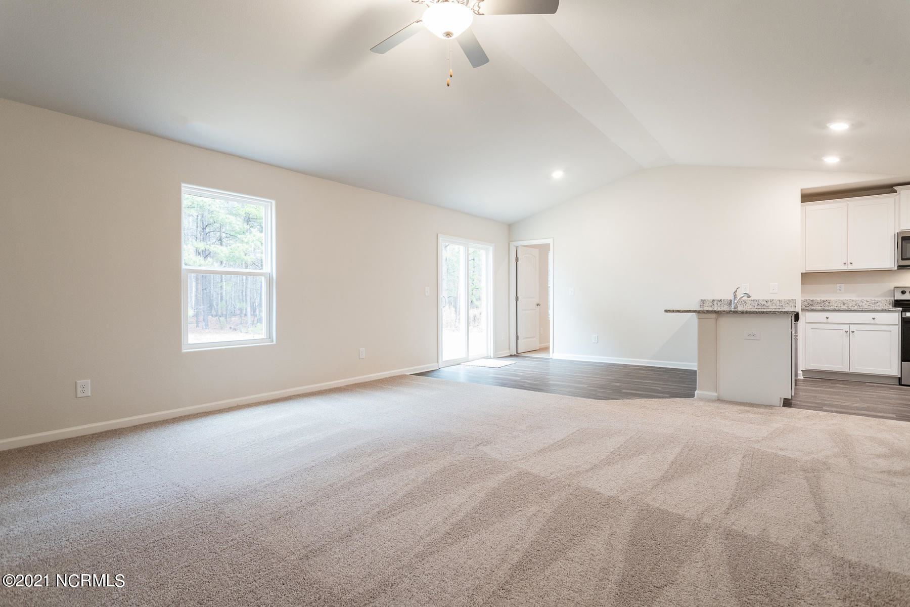 Photo of 401 Poppleton Drive, Hampstead, NC 28443 (MLS # 100293046)
