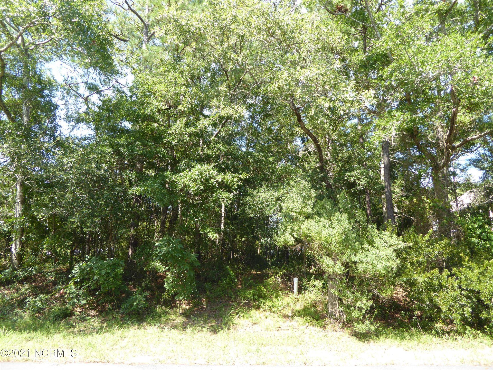 Photo of 105&107 NW 25th Street, Oak Island, NC 28465 (MLS # 100292050)