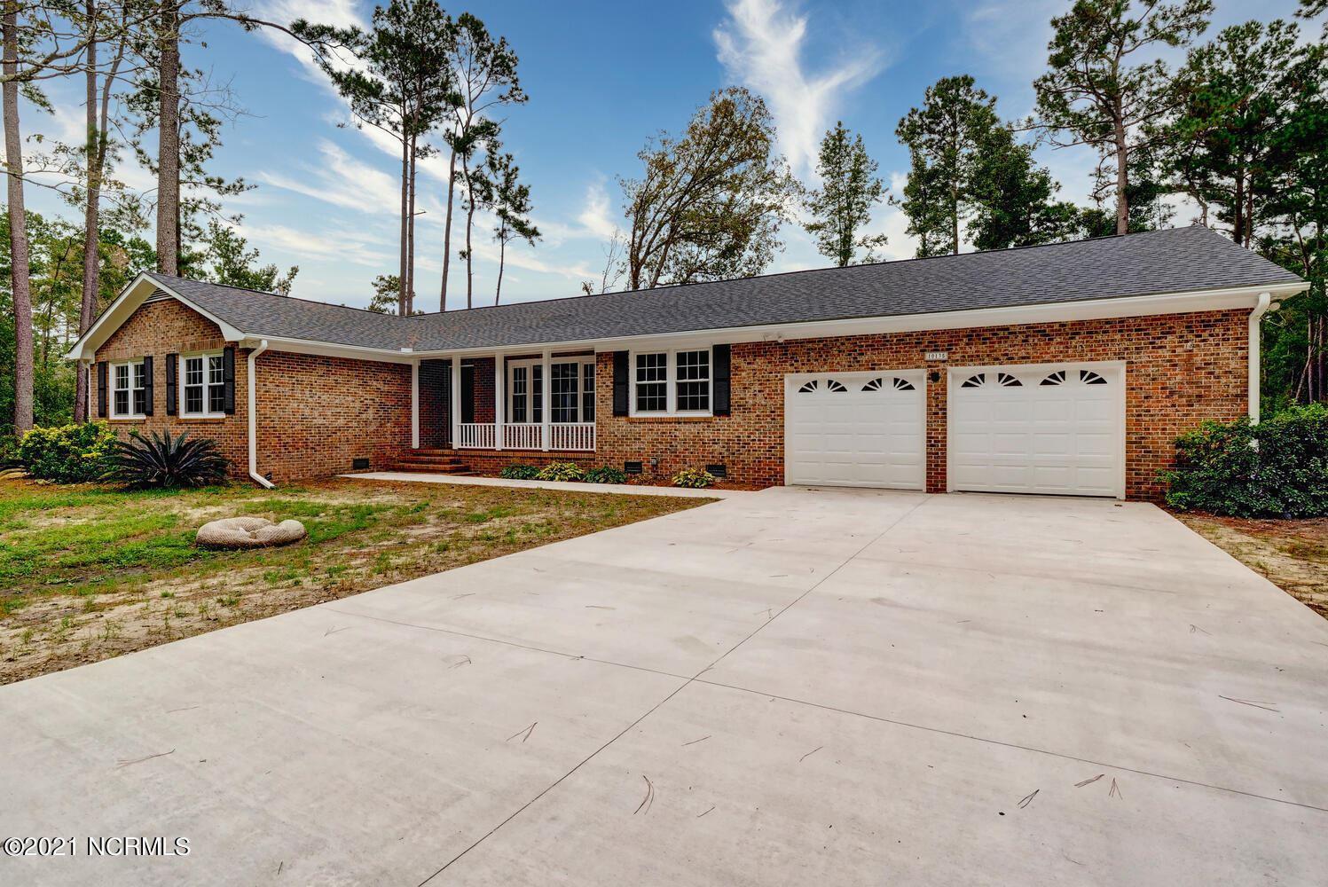 Photo of 10135 S Olde Towne Wynd SE, Leland, NC 28451 (MLS # 100295052)