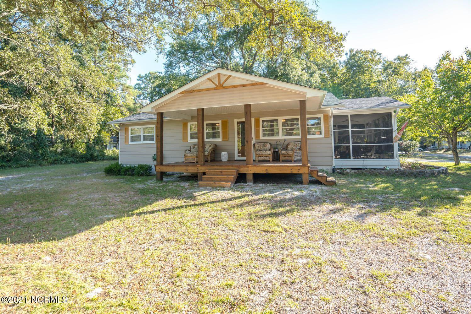 Photo of 2007 W Oak Island Drive, Oak Island, NC 28465 (MLS # 100296065)