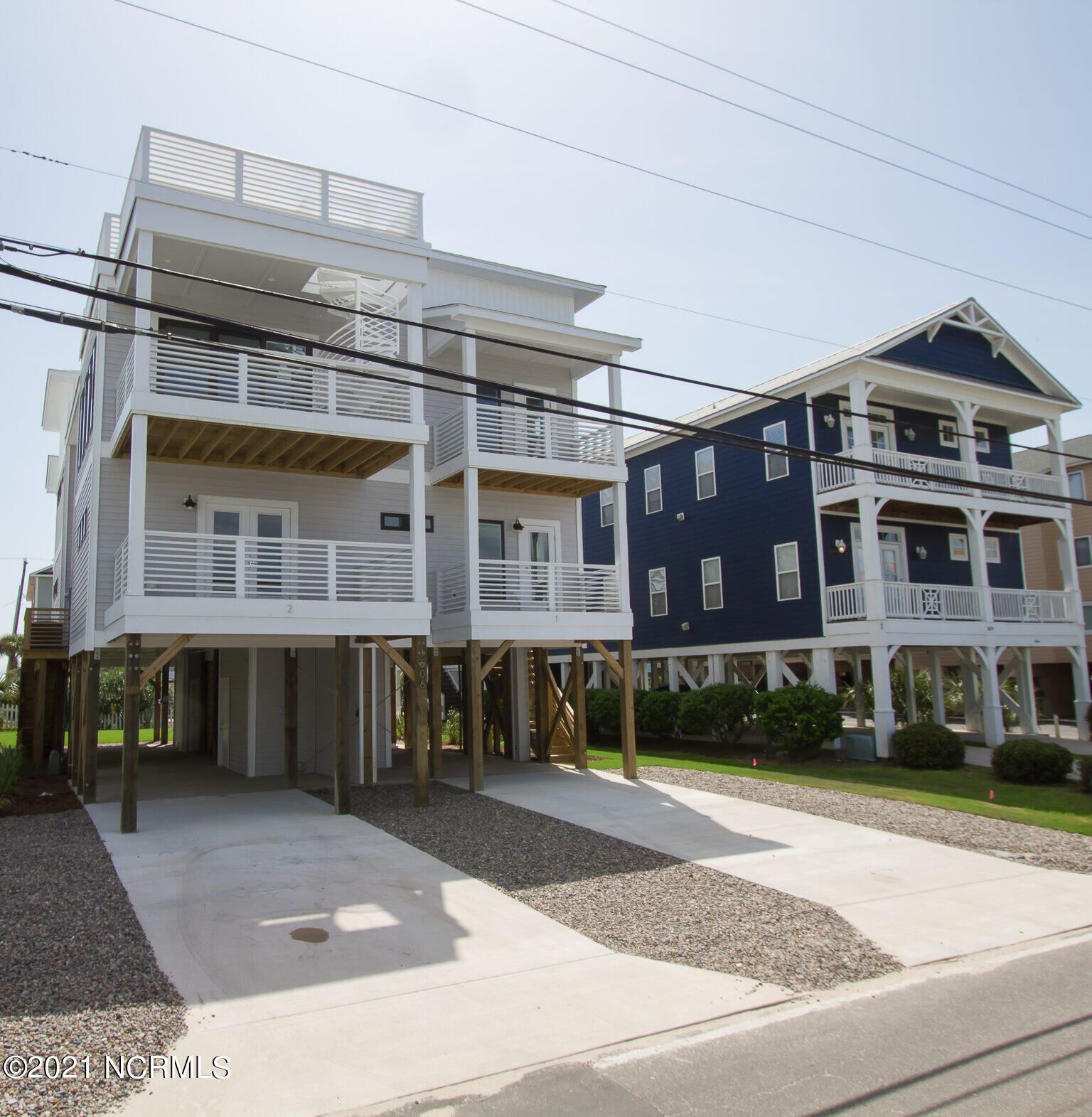 Photo of 1606 Canal Drive, Carolina Beach, NC 28428 (MLS # 100291092)
