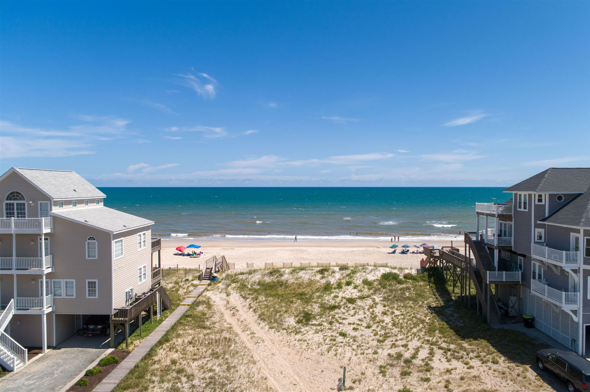 Photo of 402 New River Inlet Road, North Topsail Beach, NC 28460 (MLS # 100228104)