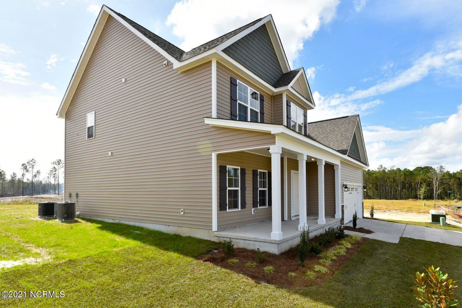Photo of 220 Bachmans Trail, Hampstead, NC 28443 (MLS # 100293122)