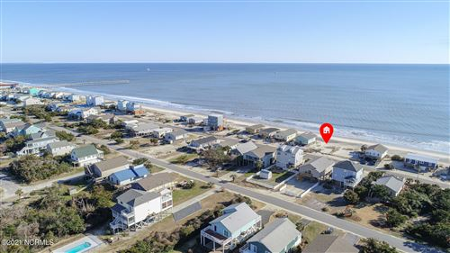 Photo of 621 E Beach Drive, Oak Island, NC 28465 (MLS # 100258136)