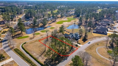 Photo of 1058 Beauvoir Drive NW, Calabash, NC 28467 (MLS # 100260141)