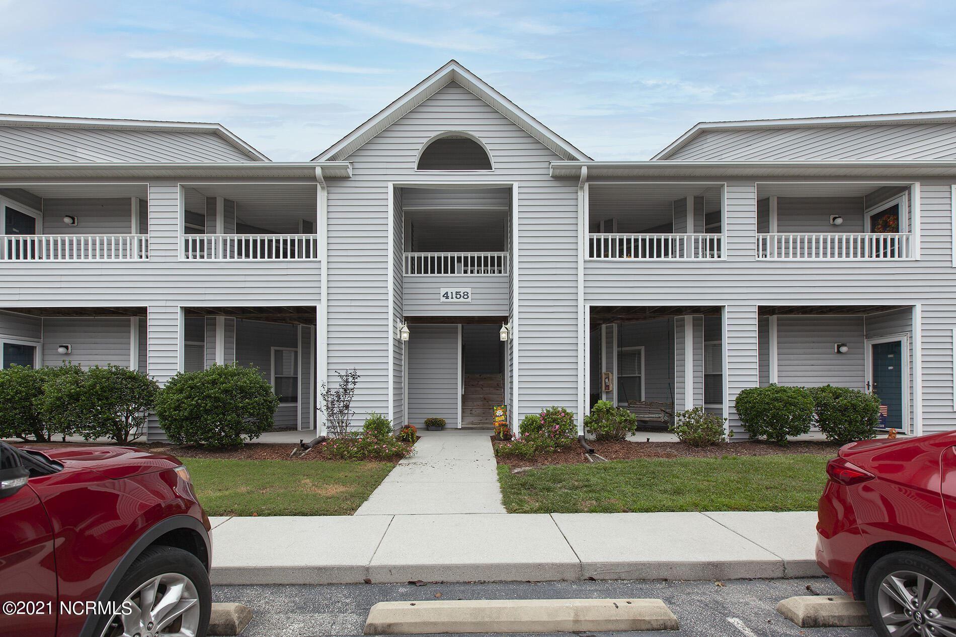 Photo of 4158 Breezewood Drive #203, Wilmington, NC 28412 (MLS # 100295146)