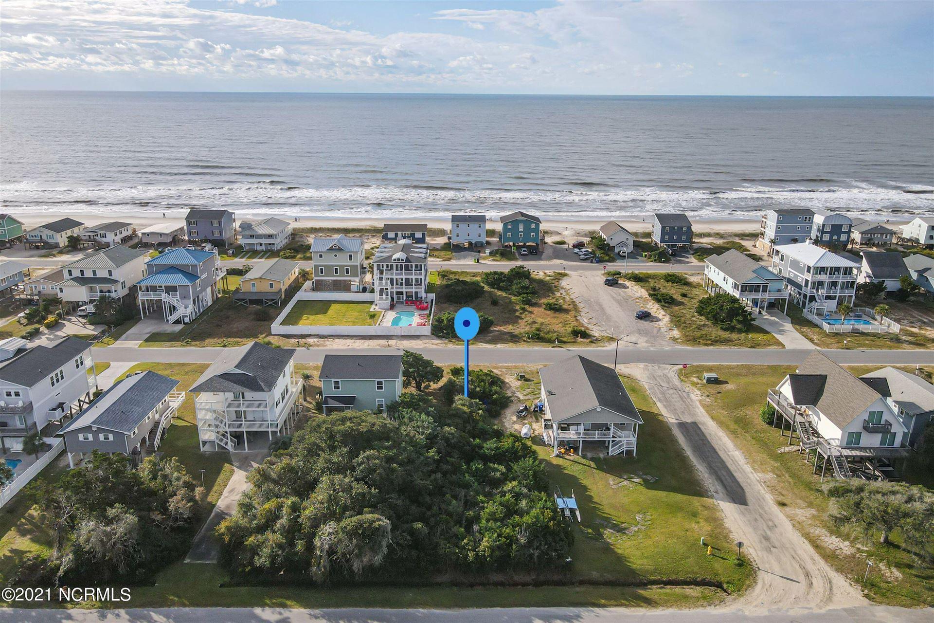 Photo of 128 W Dolphin Drive, Oak Island, NC 28465 (MLS # 100284170)