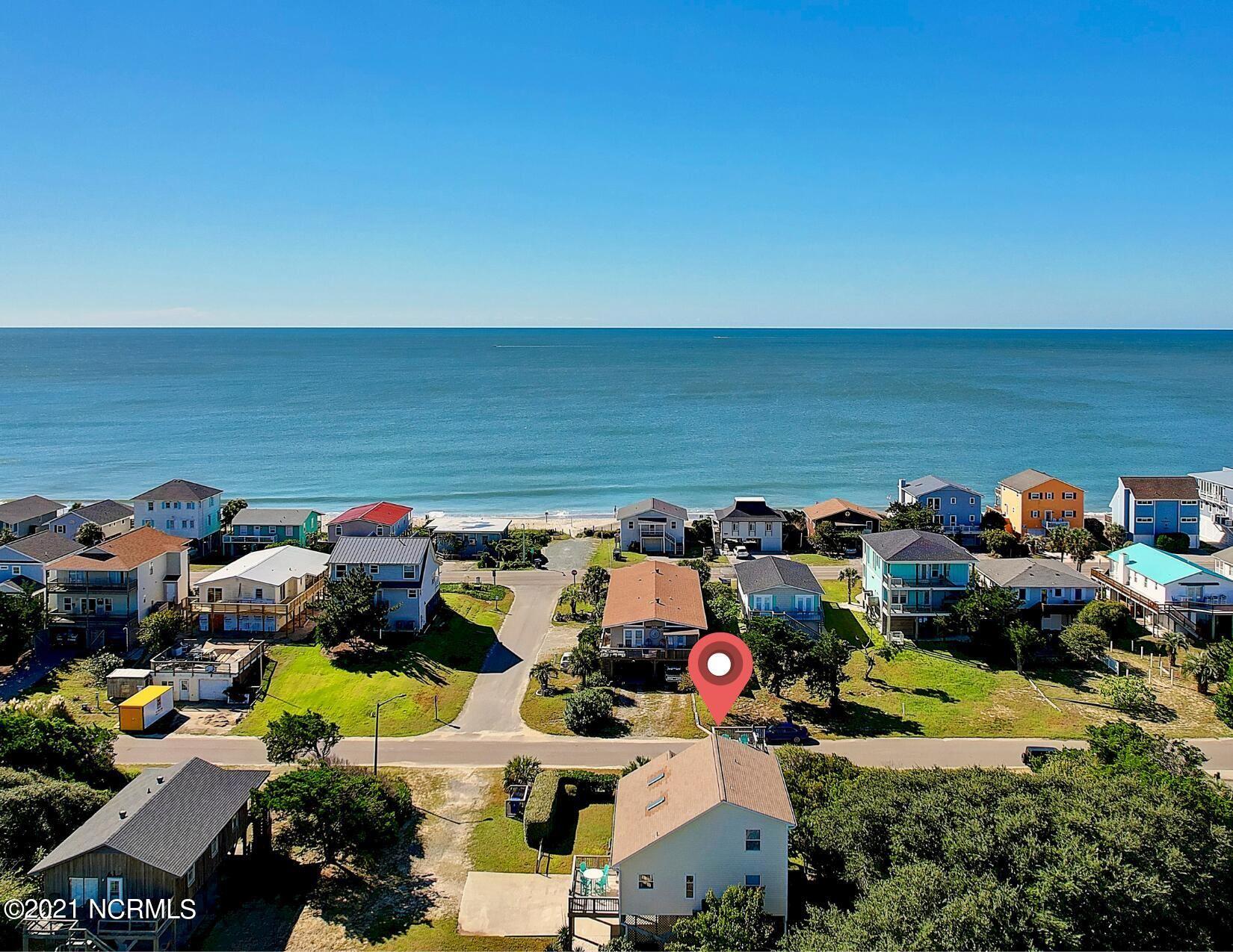 Photo of 3602 W Dolphin Drive, Oak Island, NC 28465 (MLS # 100292184)