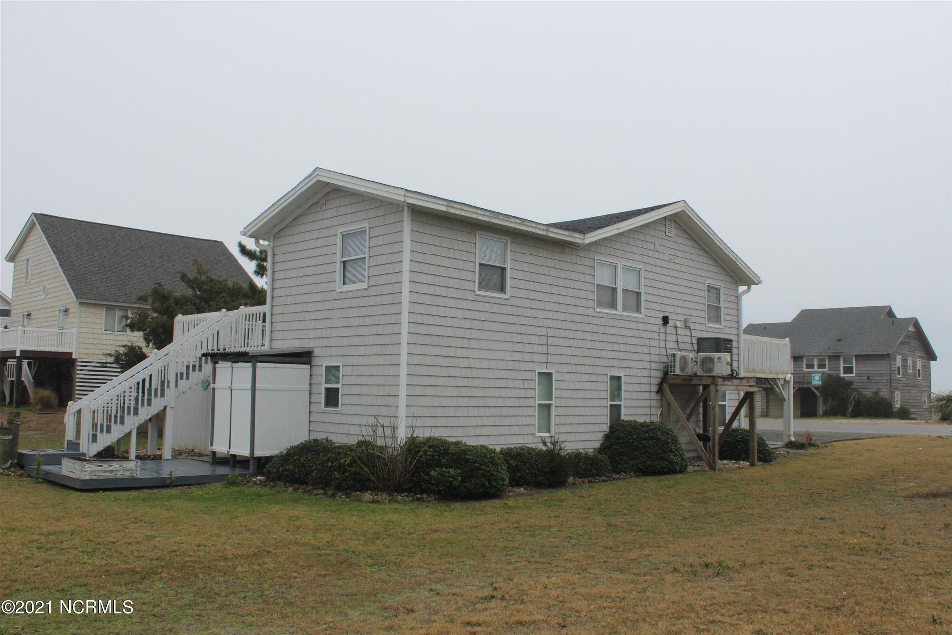 Photo of 6606 W Beach Drive, Oak Island, NC 28465 (MLS # 100254196)