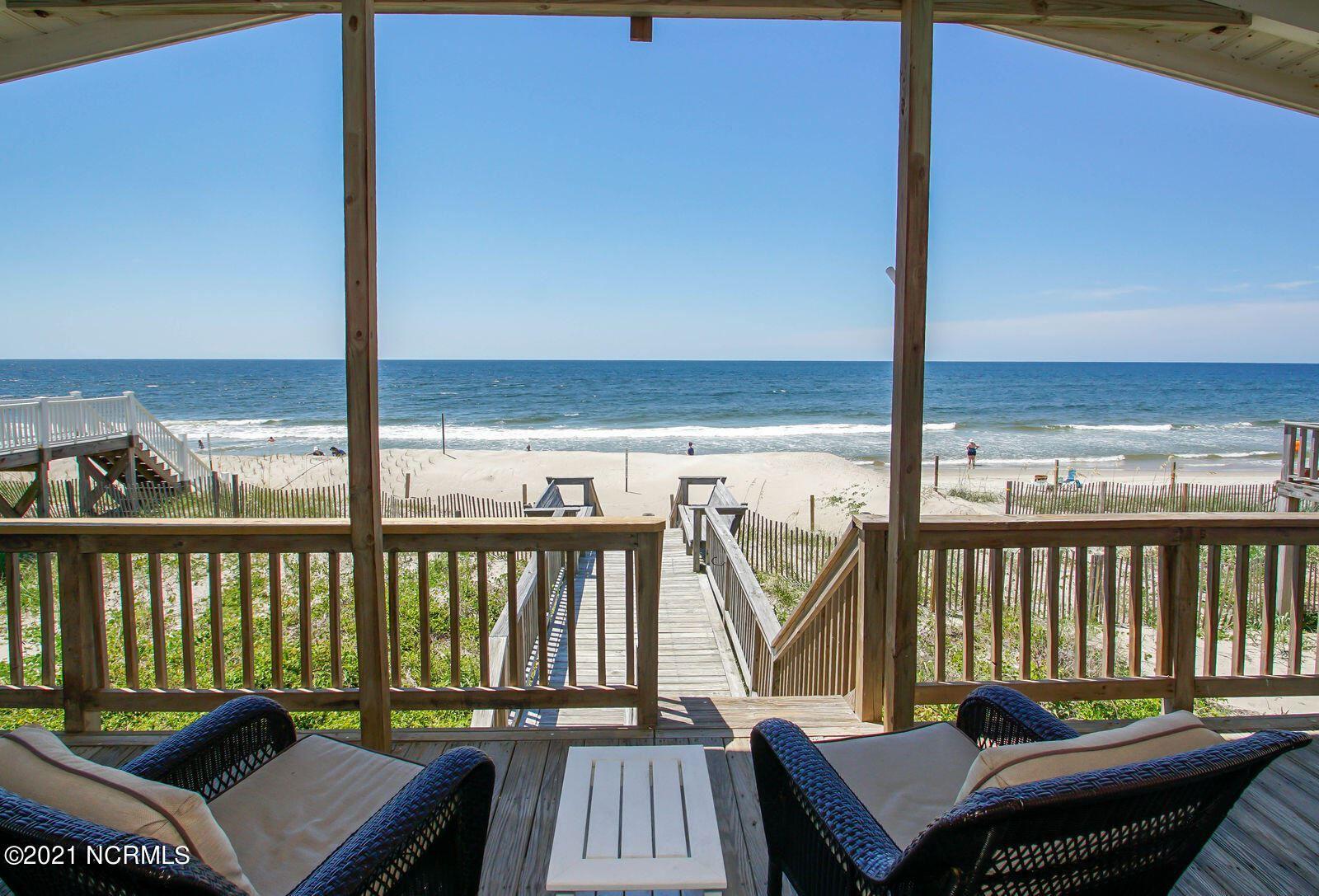 Photo of 5107 W Beach Drive, Oak Island, NC 28465 (MLS # 100293220)