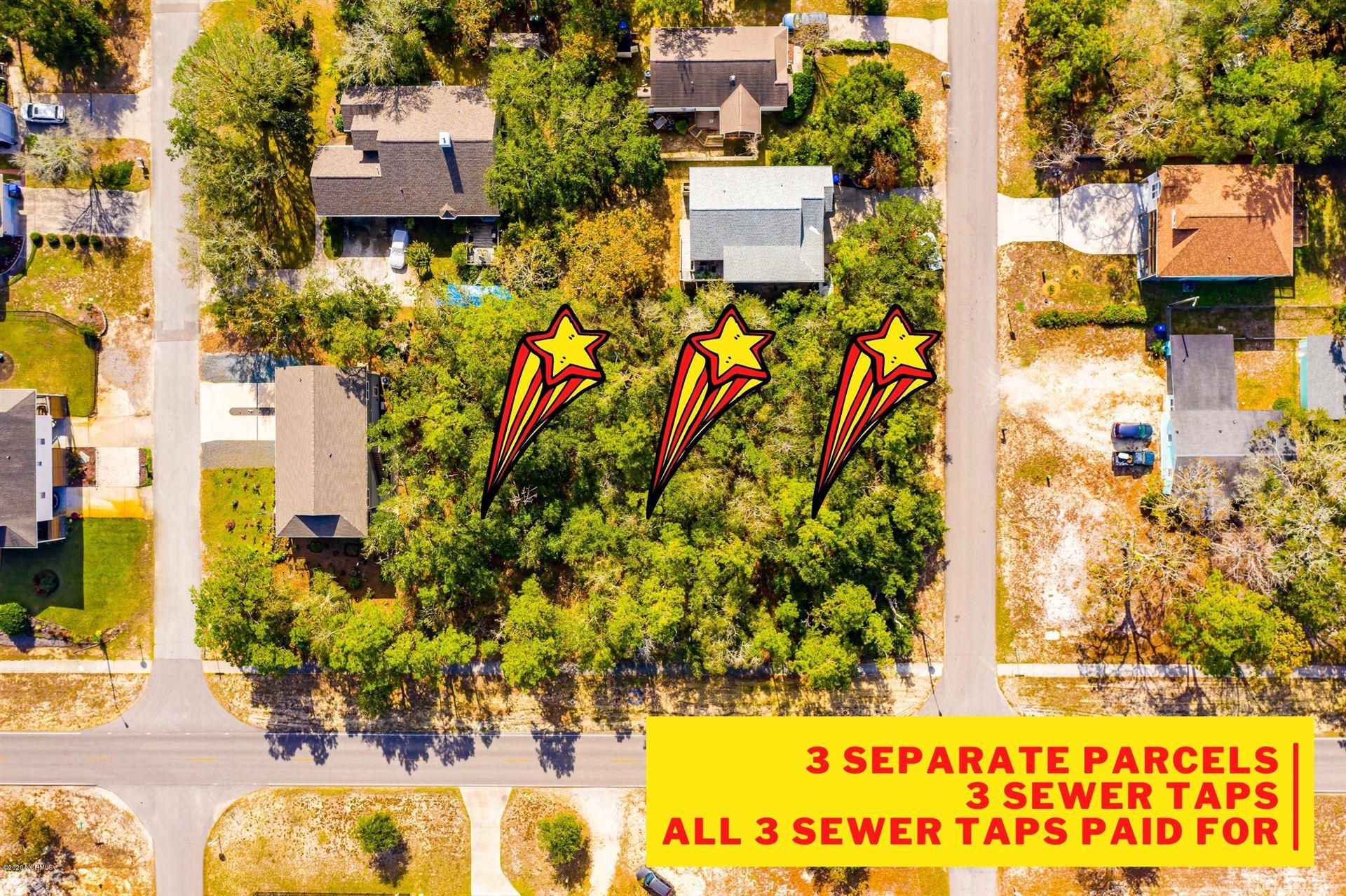 Photo of 1203 W Oak Island Drive, Oak Island, NC 28465 (MLS # 100246228)