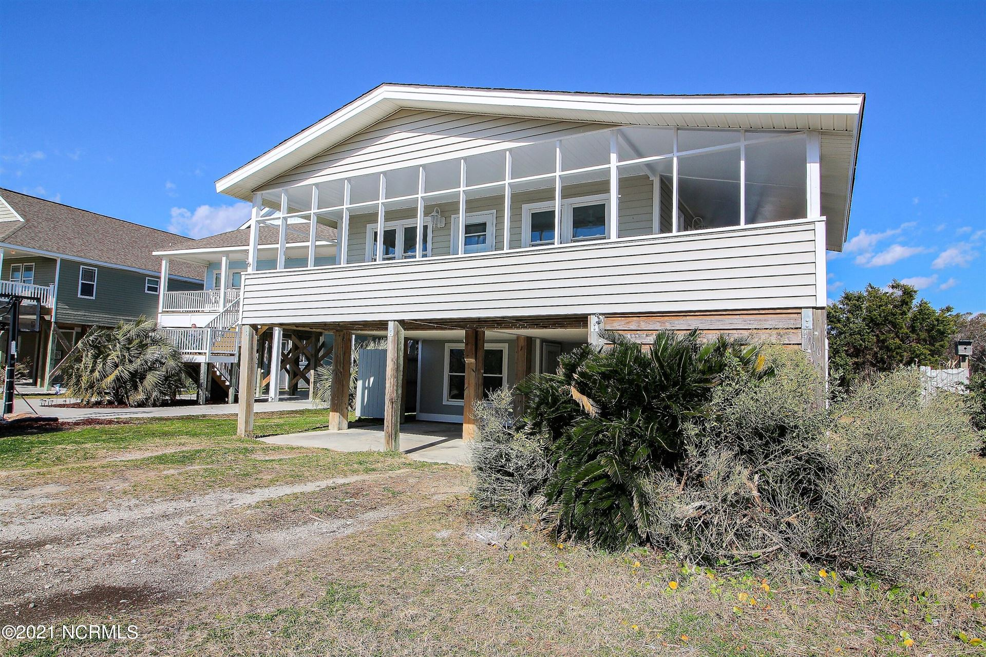 Photo of 4016 E Dolphin Drive, Oak Island, NC 28465 (MLS # 100257231)