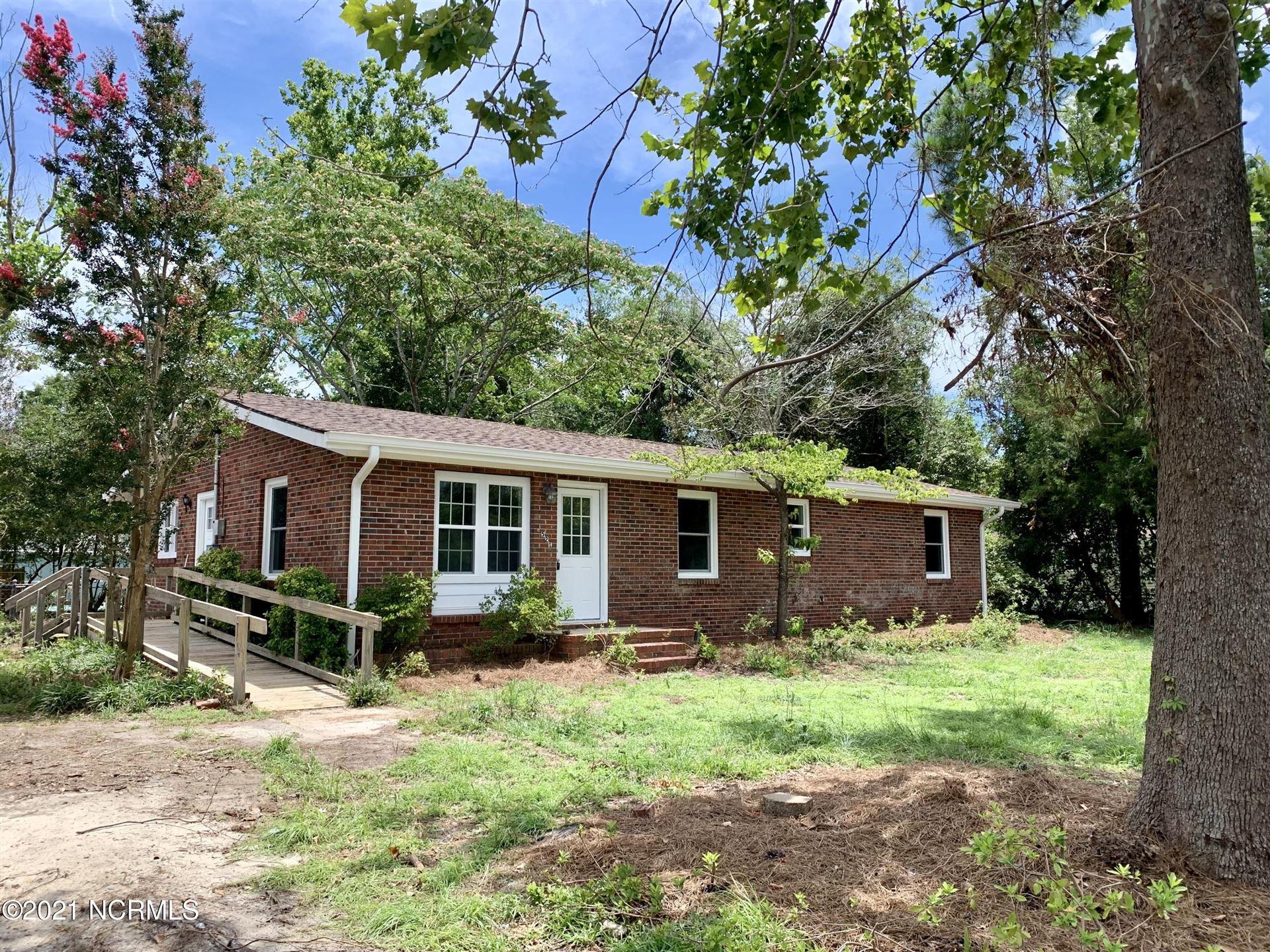 Photo of 5521 Pine Glen Street SE, Southport, NC 28461 (MLS # 100296235)