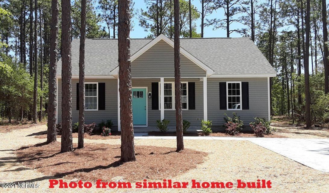Photo of 631 Charlestown Road, Southport, NC 28461 (MLS # 100284239)