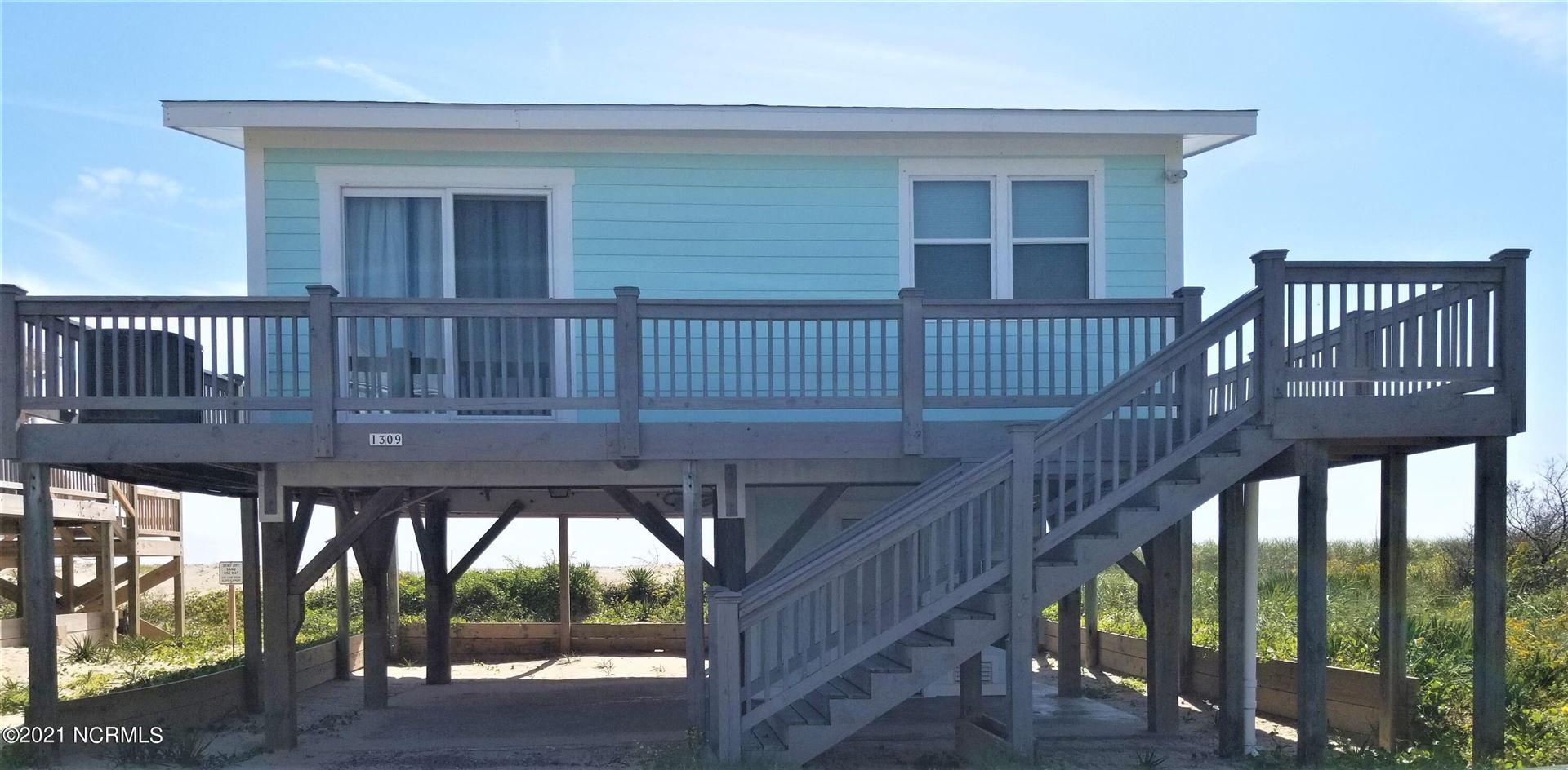 Photo of 1309 W Beach Drive, Oak Island, NC 28465 (MLS # 100296267)