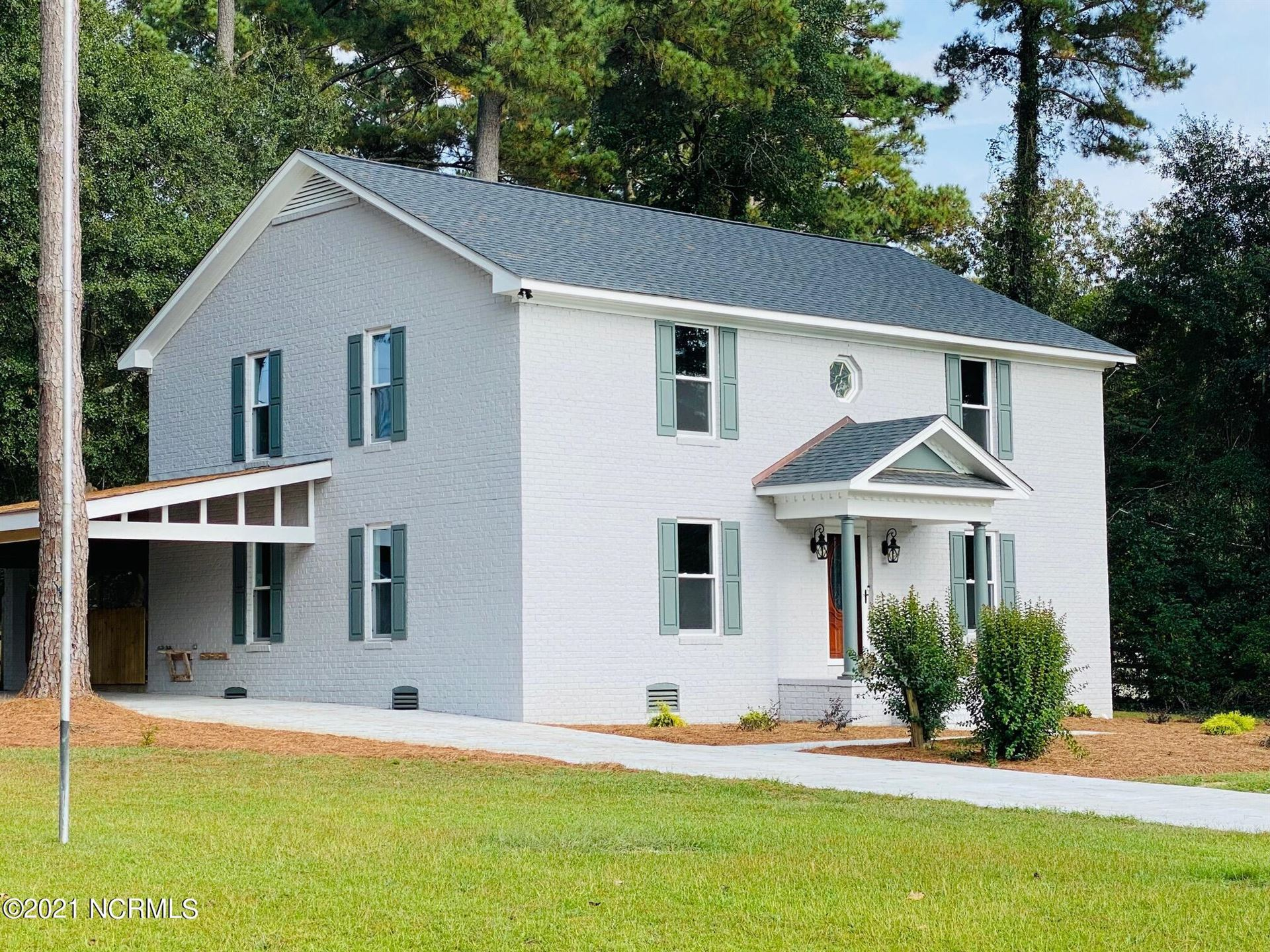 Photo of 410 Coharie Drive, Clinton, NC 28328 (MLS # 100293276)