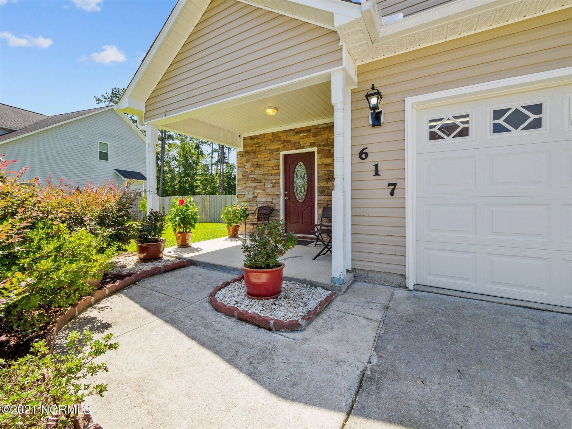 Photo of 617 Stagecoach Drive, Jacksonville, NC 28546 (MLS # 100289283)