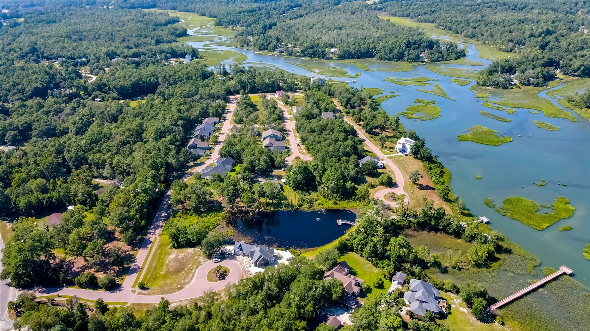 Photo of 1668 Back Bay Drive SW, Shallotte, NC 28470 (MLS # 100216288)