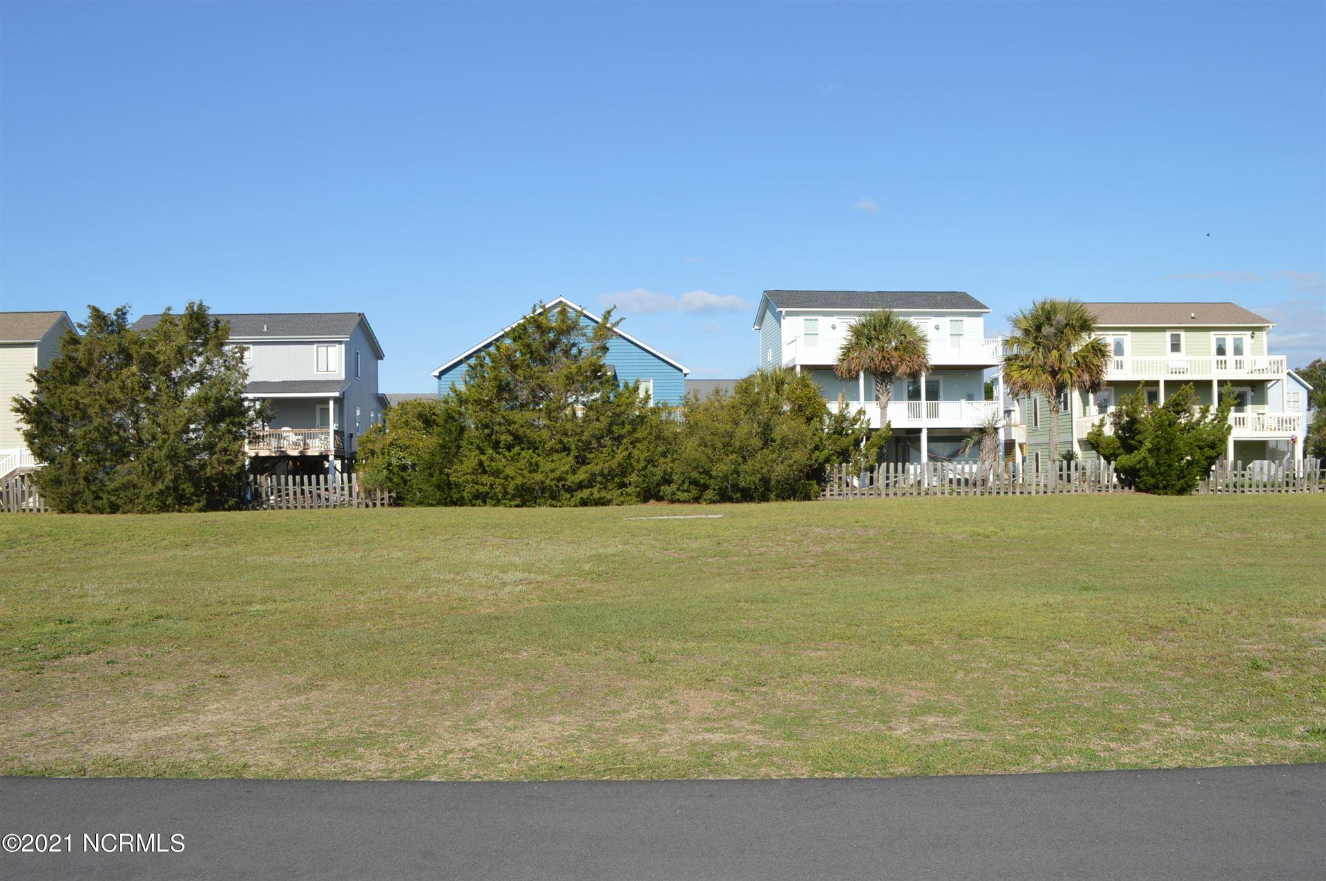 Photo of 115 Marsh Walk Walk, Holden Beach, NC 28462 (MLS # 100253313)