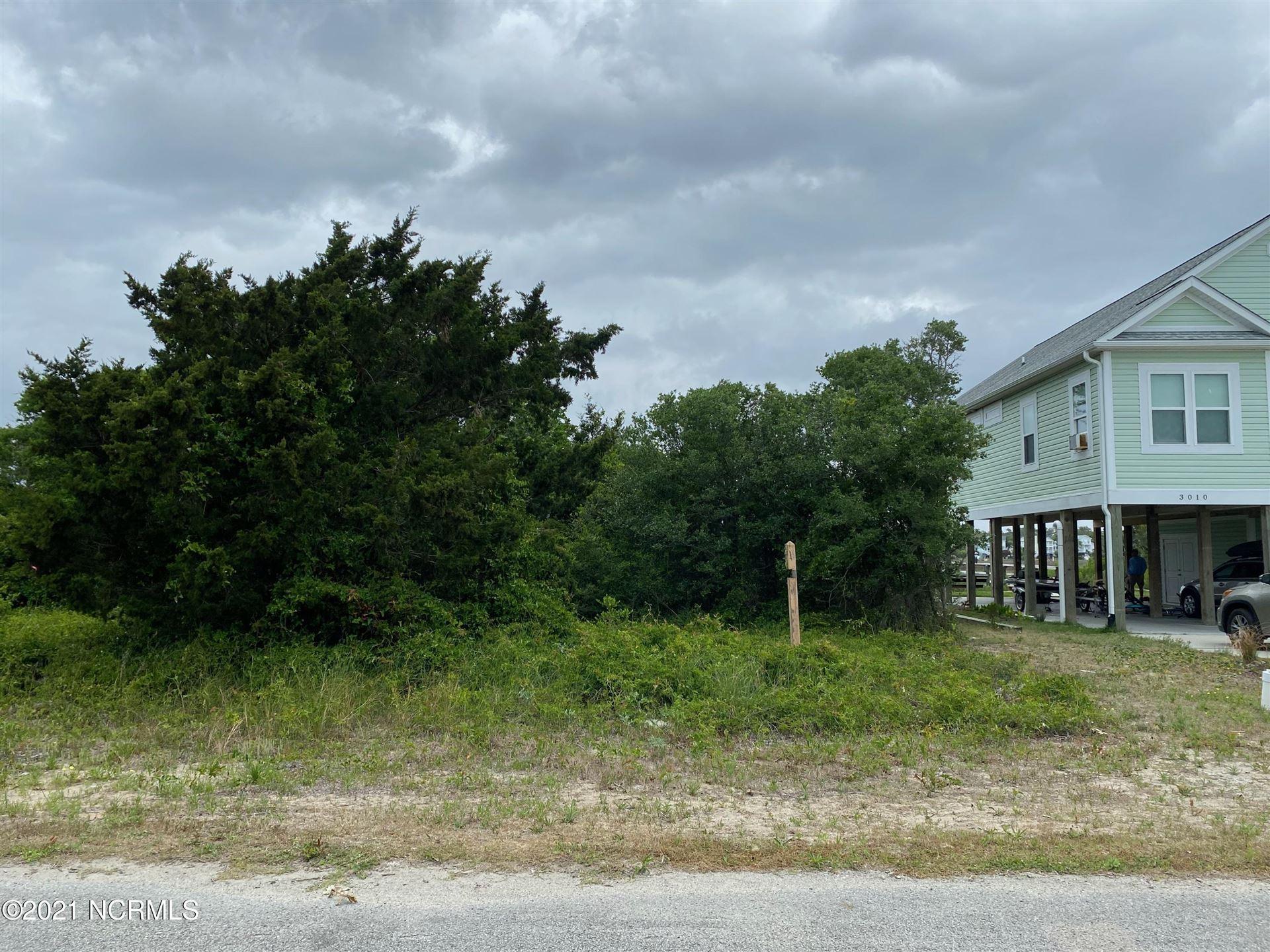 Photo of 3012 W Pelican Drive, Oak Island, NC 28465 (MLS # 100270316)