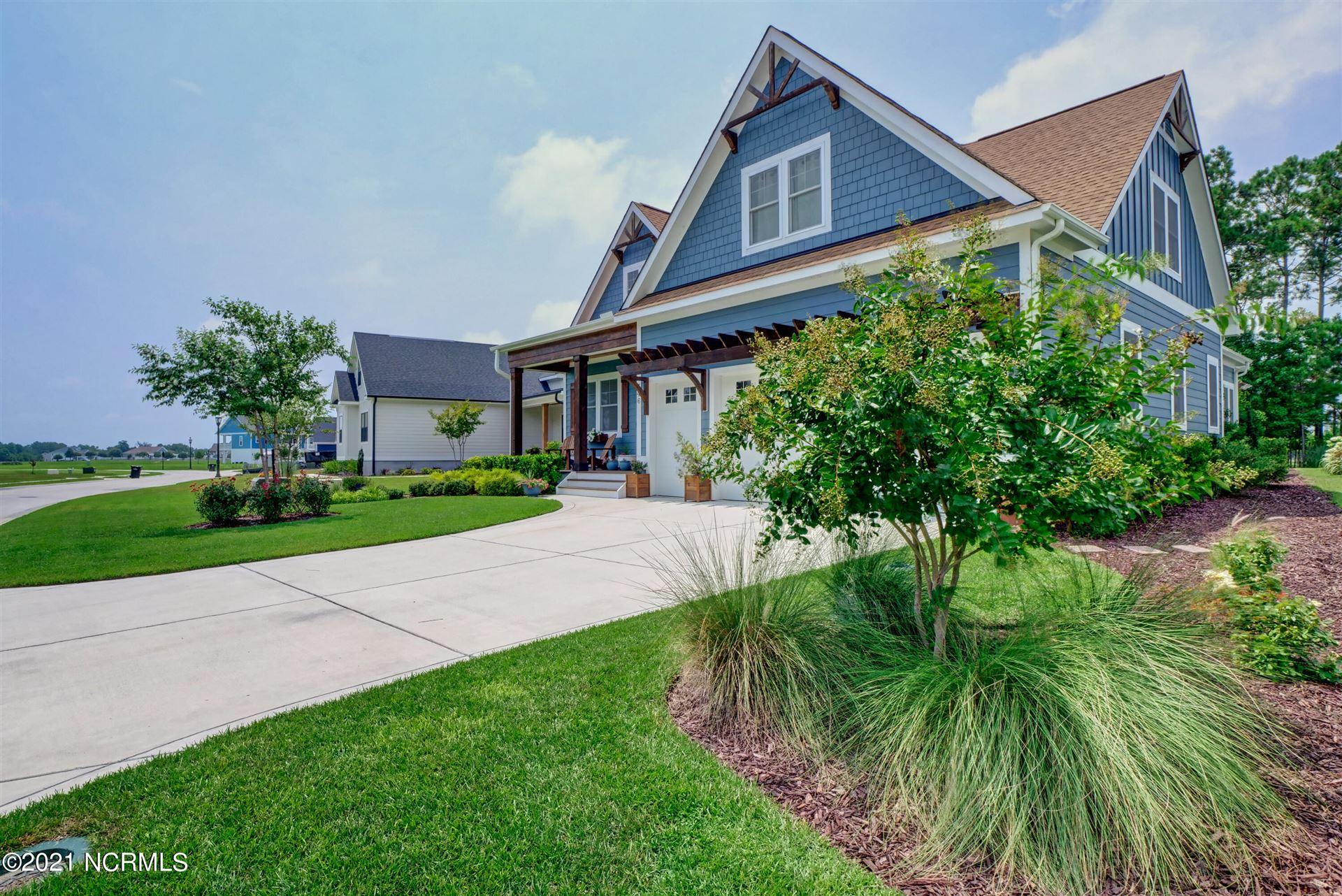 Photo of 546 Moss Lake Lane, Holly Ridge, NC 28445 (MLS # 100283363)