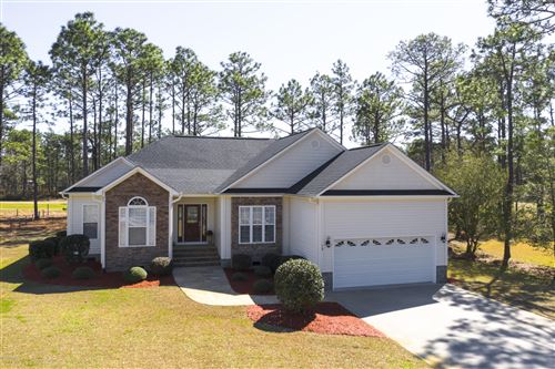 Photo of 70 Fairway Drive, Southport, NC 28461 (MLS # 100207372)