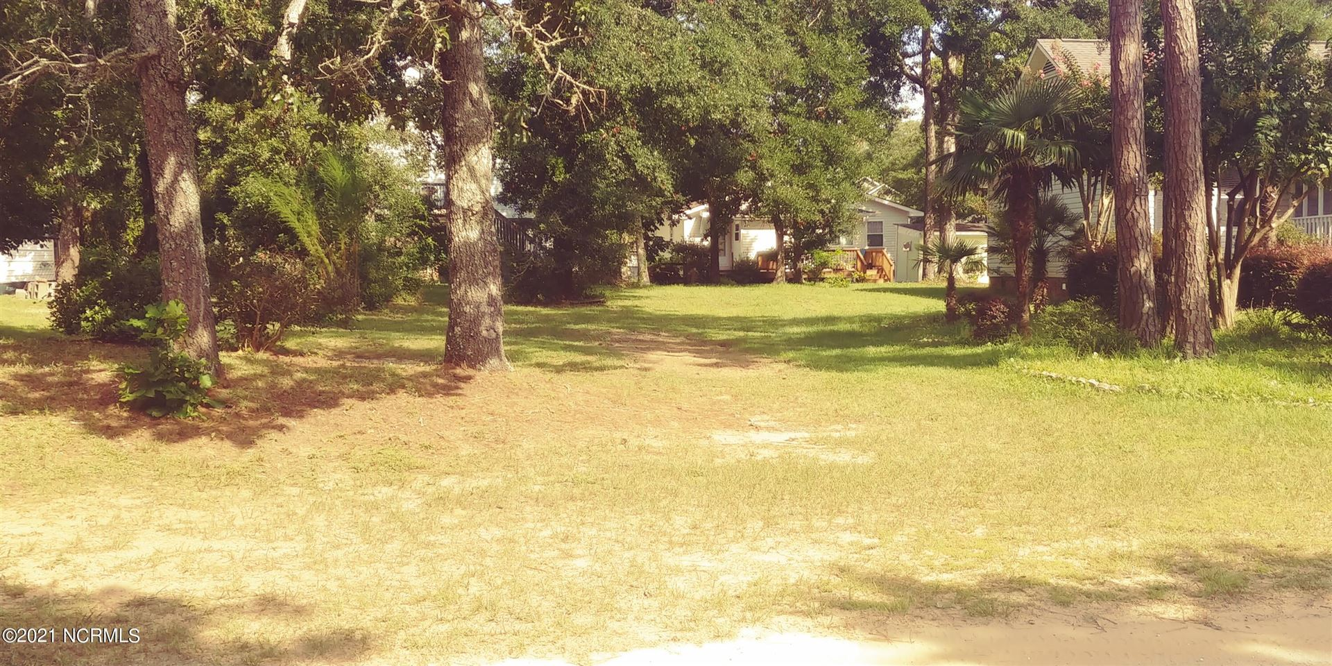 Photo of 106 NE 34th Street, Oak Island, NC 28465 (MLS # 100288381)