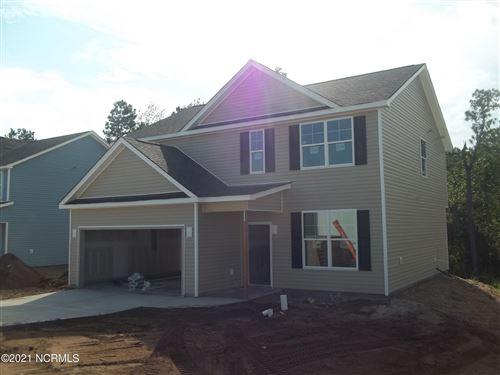 Photo of 911 W Arboria Drive, Hampstead, NC 28443 (MLS # 100282398)