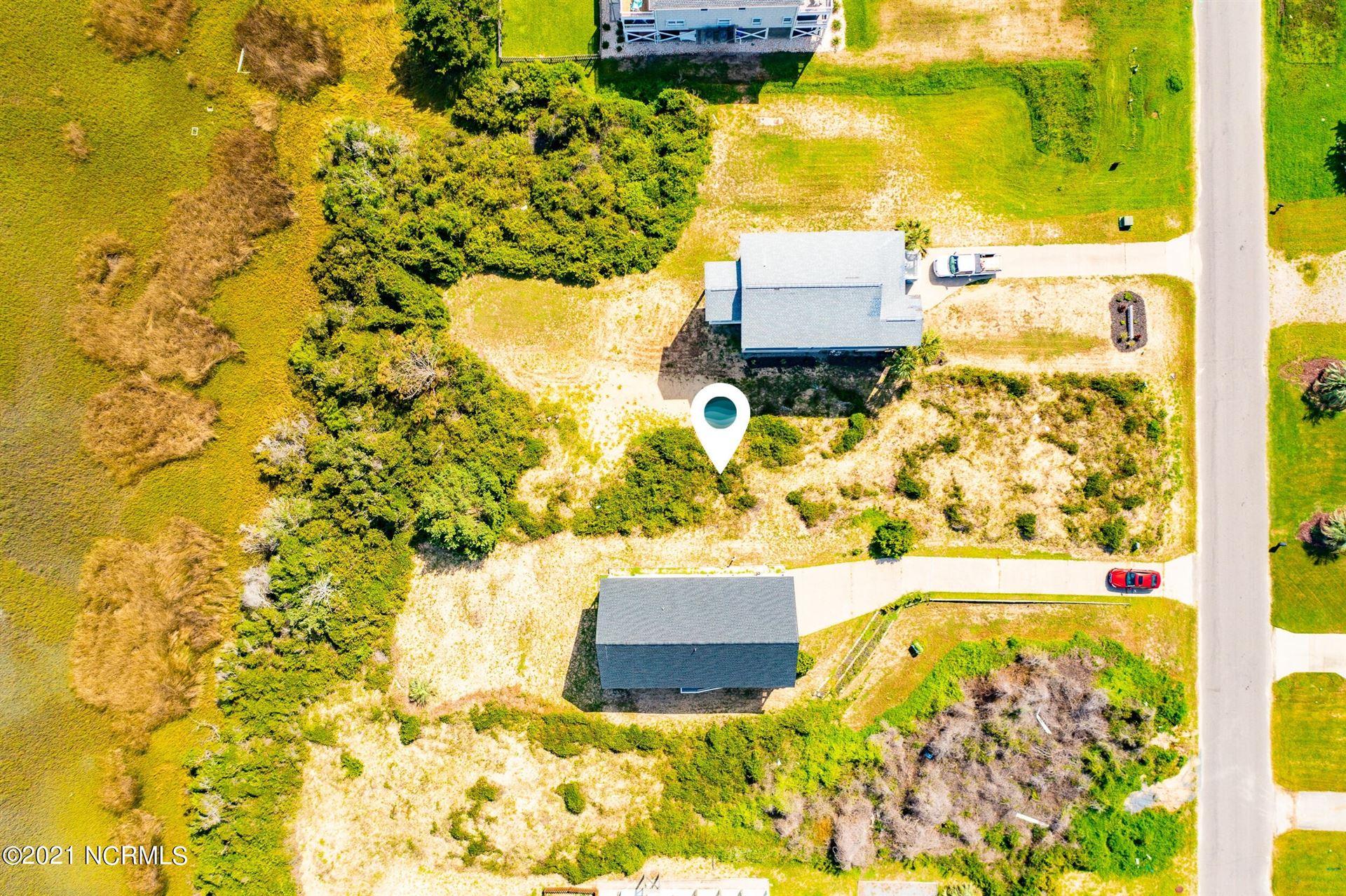 Photo of 1308 W Dolphin Drive, Oak Island, NC 28465 (MLS # 100294406)